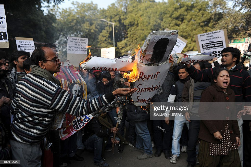 Indian students shout slogans as they burn an effigy of Indian spiritual guru Asharam during a protest in New Delhi on January 8, 2013. Asharam sparked a backlash Tuesday after saying a 23-year-old student could have averted a murderous gang-rape by begging for mercy from her attackers. The 71-year-old's remarks - the latest in a series of gaffes by public figures blaming women for the country's rape epidemic - drew a chorus of condemnation.