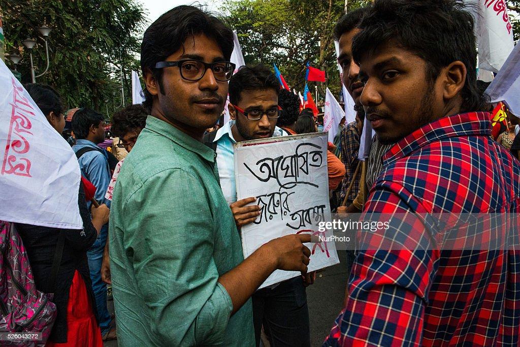 Indian students shout slogans during a protest against the arrest of a Jawaharlal Nehru University student union president Kanhaiya Kumar in Kolkata...