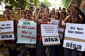 Indian students shout slogans during a protest against the rapes of two minor girls outside the police headquarters in New Delhi on October 18 2015...