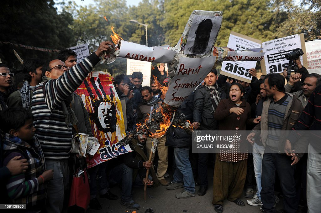 Indian students shouts slogans as they burn an effigy of Indian spiritual guru Asharam during a protest in New Delhi on January 8, 2013. Asharam sparked a backlash Tuesday after saying a 23-year-old student could have averted a murderous gang-rape by begging for mercy from her attackers. The 71-year-old's remarks - the latest in a series of gaffes by public figures blaming women for the country's rape epidemic - drew a chorus of condemnation. AFP PHOTO/SAJJAD HUSSAIN
