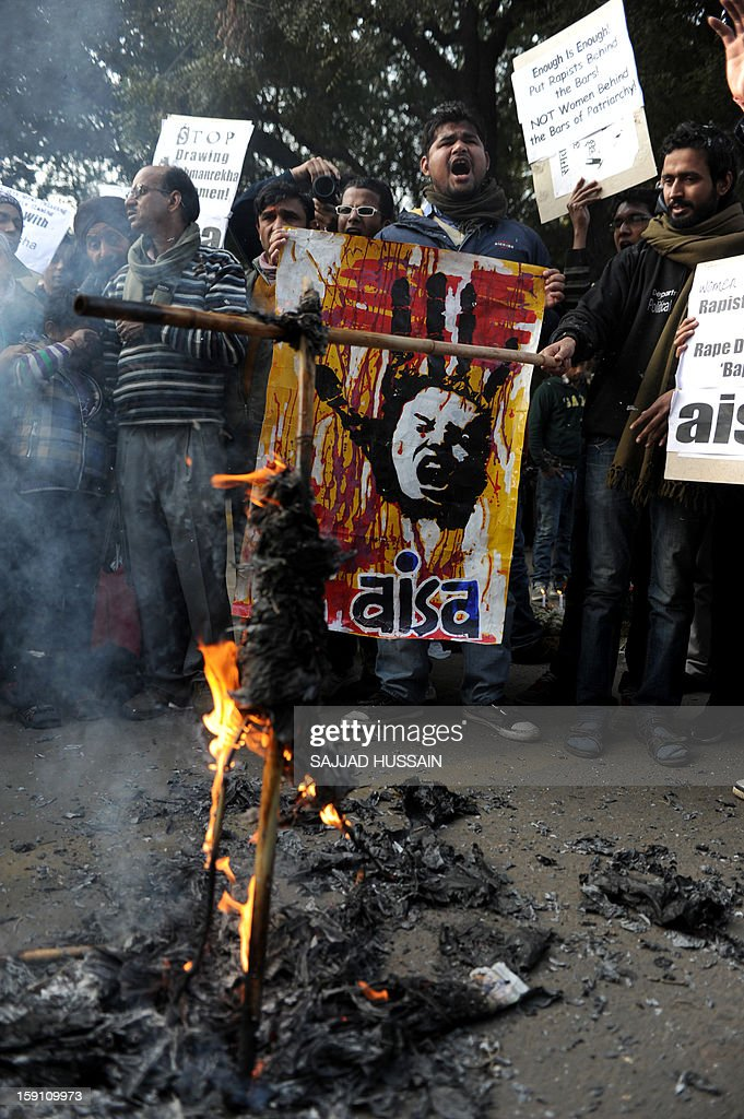 Indian students shouts slogans as they burn an effigy of Indian spiritual guru Asharam during a protest in New Delhi on January 8, 2013. Asharam sparked a backlash Tuesday after saying a 23-year-old student could have averted a murderous gang-rape by begging for mercy from her attackers. The 71-year-old's remarks - the latest in a series of gaffes by public figures blaming women for the country's rape epidemic - drew a chorus of condemnation.