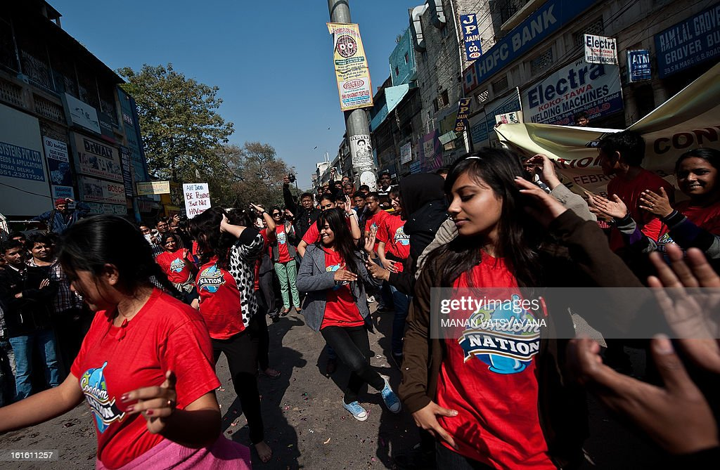 Indian students take part in a flash mob to spread 'safe sex awareness ' in New Delhi on February 13, 2013 on the occasion of International Condom Day. AIDS Healthcare Foundation (AHF) organised a 'Safe Sex Awareness' event in the Indian capital to promote the use of condom to prevent spread of HIV infections and sexually transmitted diseases. AFP PHOTO/ MANAN VATSYAYANA