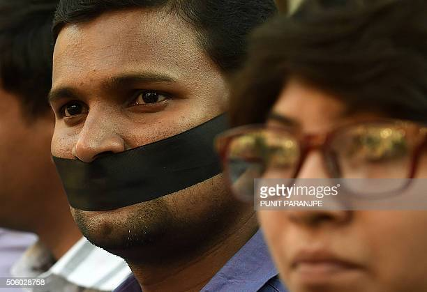 Indian students take part in a silent protest after a student found was dead at a university hostel in Mumbai on January 21 2016 Rohit Vemula a...