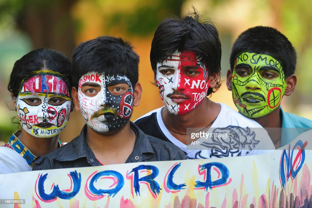 Indian students, their faces painted with anti-smoking messages, pose during World No Tobacco Day in Allahabad on May 31, 2013. Governments worldwide must ban all forms of tobacco marketing, not just billboards and TV ads, as companies find new ways to tap the market, the World Health Organization said May 29.