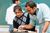 indian students looking at a monitor lizard skeleton