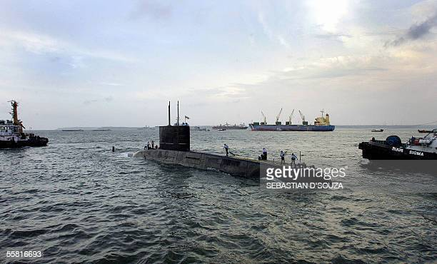 Indian submarine 'INS Shalki' leaves port during the ongoing joint IndoUS naval excercise off the Goa coast 28 September 2005 The United States and...