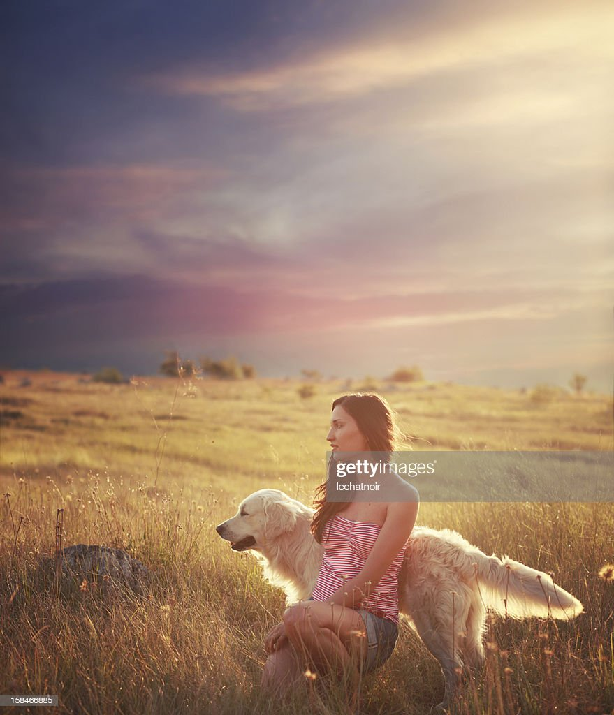 Indian summer portrait of a girl with her dog