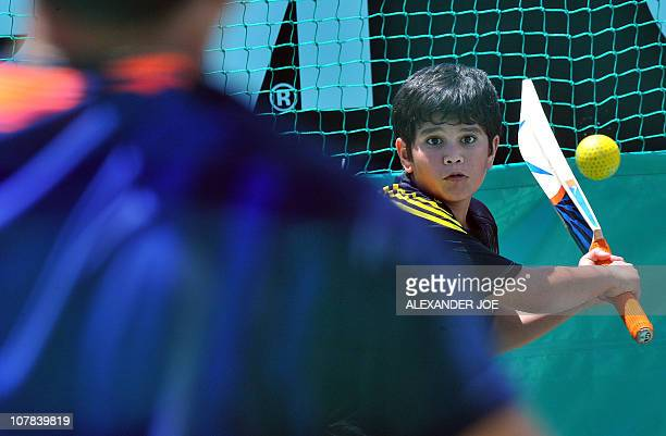 Indian superstar cricketer Sachin Tendulkar stands next to his son Arjun at Newlands Stadium in Cape Town on Janurary 1 2011 on the eve of the third...