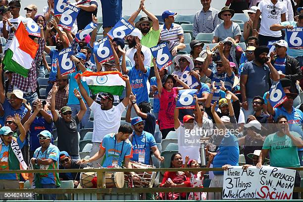 Indian supporters celebrate a six during the Victoria Bitter One Day International Series match between Australia and India at WACA on January 12...