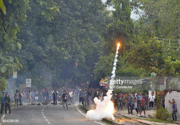 Indian supporters of a separate Gorkhaland state clash with police during an indefinite strike at Sukna village in Darjeeling district on the...