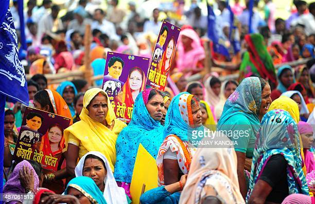 Indian supporters of Bahujan Samaj Party gather to listen to president Mayawati address an election rally in support of local candidates in Allahabad...