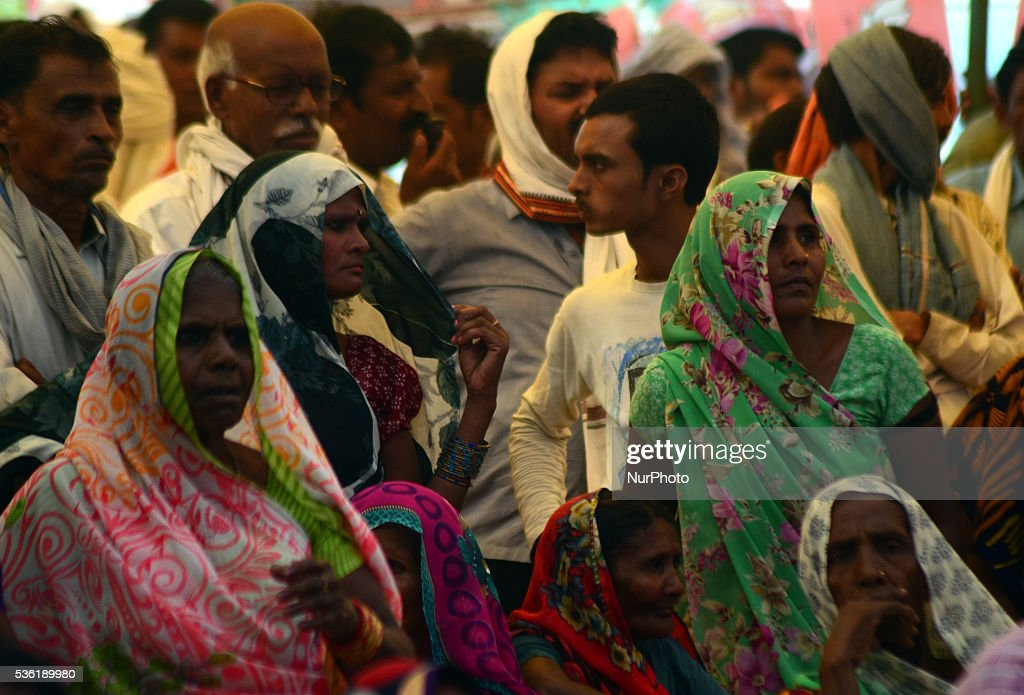 Indian supporters of Bhartiya Janta Party listen to national president of BJP Amit Shah's speech during Sardar Patel Kisan rally, in Allahabad on May 31,2016.