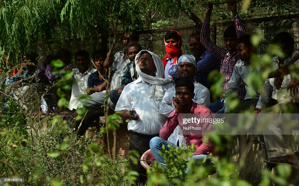 Indian supporters of Bhartiya janta party (BJP) listen to national president of BJP Amit Shah's speech in Sardar Patel Kisan rally, in Allahabad on May 31,2016.