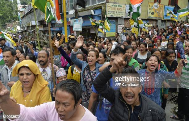 Indian supporters of Gorkha Janamukti Morcha chant slogans during the 23th day of an indefinite strike called by GJM in Darjeeling on July 7 2017...