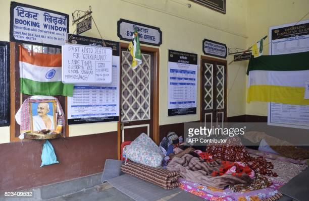 Indian supporters of Gorkhaland movement lay at Kurseong rail station during a hunger strike protest during the 43th day of an indefinite strike for...
