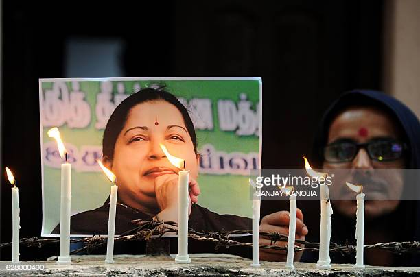 TOPSHOT Indian supporters of Indian politician and actress Jayalalithaa Jayaraman light candles as they pay tribute after her death in Allahabad on...