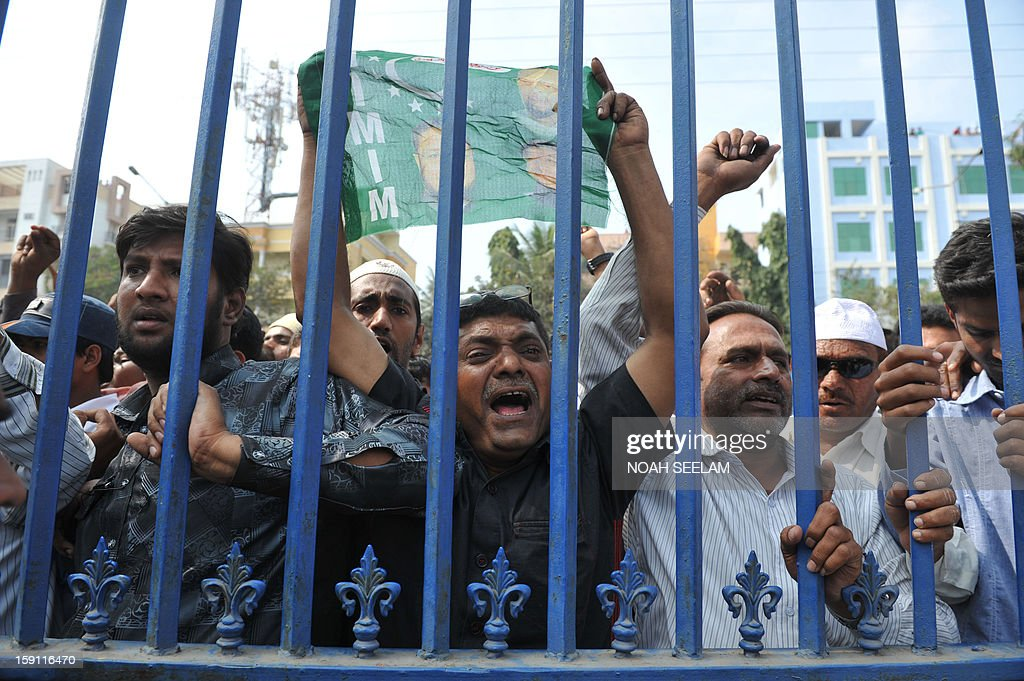 Indian supporters of Majlis-e-Ittehadul Muslimeen (MIM) party shout slogans after the arrest of their leader Akbaruddin Owaisi in Hyderabad on January 8, 2013. Owaisi, who is facing multiple cases for his alleged 'hate speech', was arrested by the police. AFP PHOTO/Noah SEELAM