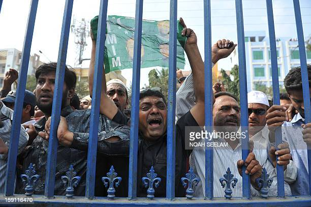 Indian supporters of MajliseIttehadul Muslimeen party shout slogans after the arrest of their leader Akbaruddin Owaisi in Hyderabad on January 8 2013...