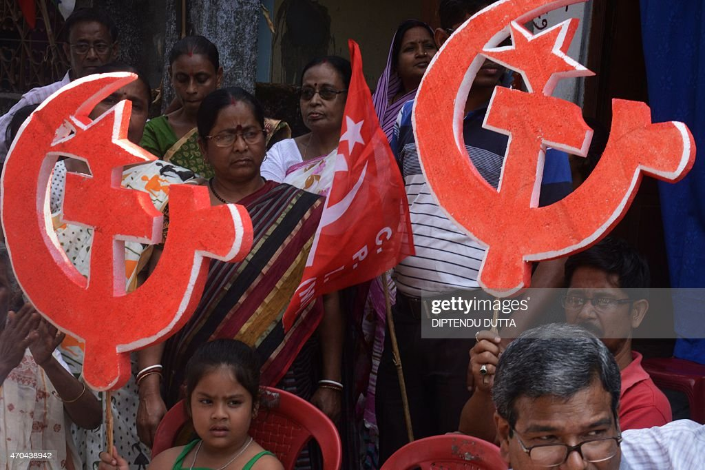 Indian supporters of the Communist Party of India hold cutouts of the party symbol during an election campaign rally for the forthcoming state...