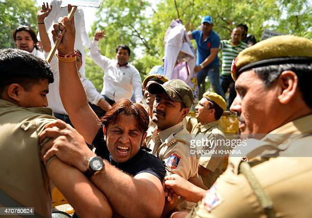 Indian supporters of the Delhi Pradesh Youth Congress shout slogans against Delhi Chief Minister Arvind Kejriwal as they clash with police outside...