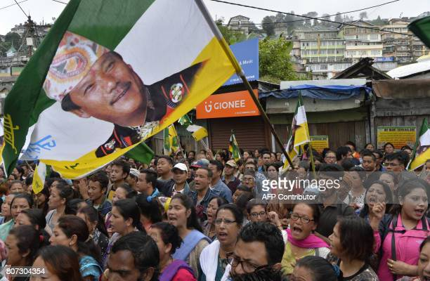 Indian supporters of the Gorkha Janmukti Morcha chant slogans as they take part in a protest during an indefinite strike called by the GJM in...