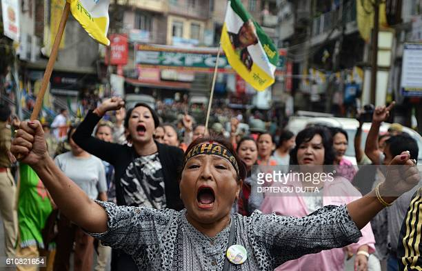 TOPSHOT Indian supporters of the Gorkha People's Liberation Front take part in a rally during a strike demanding a new Indian state at Kalimpong town...
