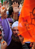 Indian supporters of the Hindu nationalist opposition Bharatiya Janata Party celebrate the victory of their candidate in the state assembly elections...