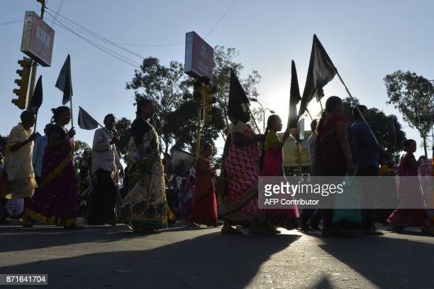 Indian supporters of Trinamul Congress Party shout slogans during a protest rally on the first anniversary of India's demonetisation scheme in...