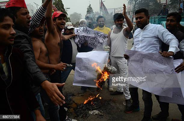 Indian supporters of Uttar Pradesh's Chief Minister Akhilesh Yadav burn the effigy of Samajwadi Party's state president and Akhilesh Yadav's uncle...