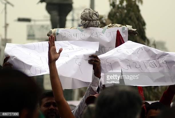Indian supporters of Uttar Pradesh's Chief Minister Akhilesh Yadav prepare to burn the effigy of Samajwadi Party's state president and Akhilesh...