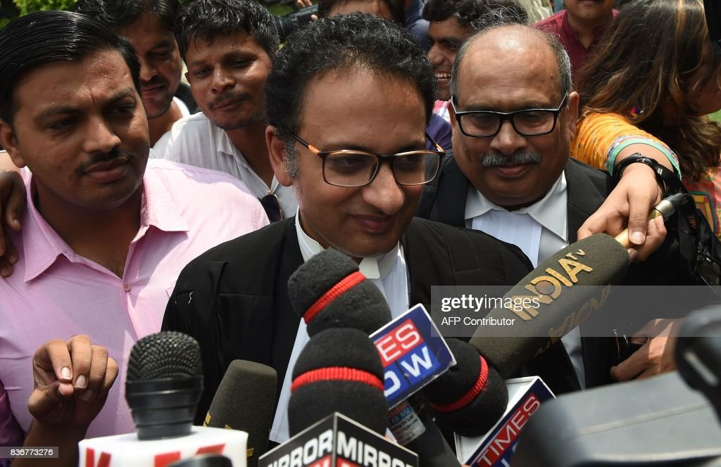 Indian Supreme Court advocate Saif Mahmood (C) meets with the press outside the Supreme Court in New Delhi on August 22, 2017. India's top court on August 22 banned a controversial Islamic practice that allows men to divorce their wives instantly, ending a long tradition that many Muslim women had fiercely opposed. PHOTO / Money SHARMA