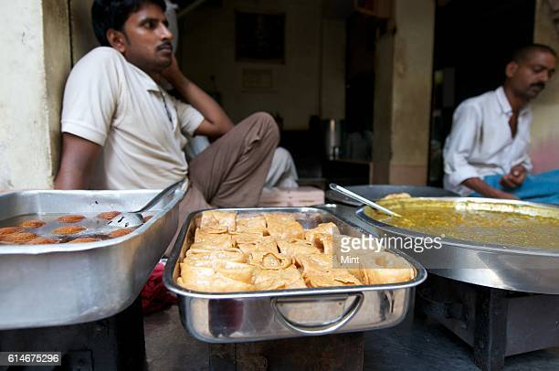 Indian sweets Long latta and Gulab Jamun on sale on July 20 2013 in Varanasi India Varanasi also known as Benaras is one of the oldest cities in...