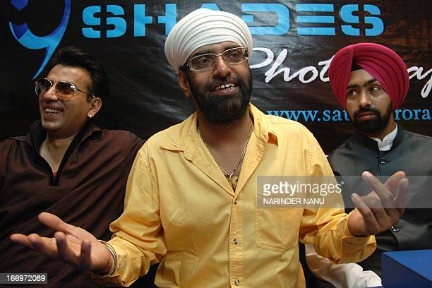 Indian tabla player and actor Surinder Singh gestures during a press conference in Amritsar on April 19 2013 Singh is currently promoting his new...