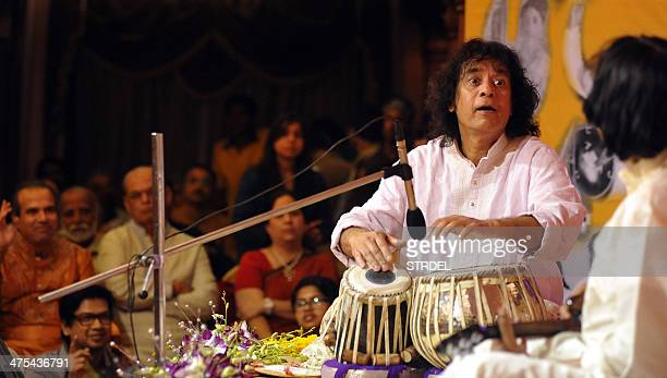 Indian tabla player Ustad Zakir Hussain performs with Mandolin player U Srinivas for the 14th Vasantotsav in Mumbai on February 27 2014 AFP PHOTO/STR