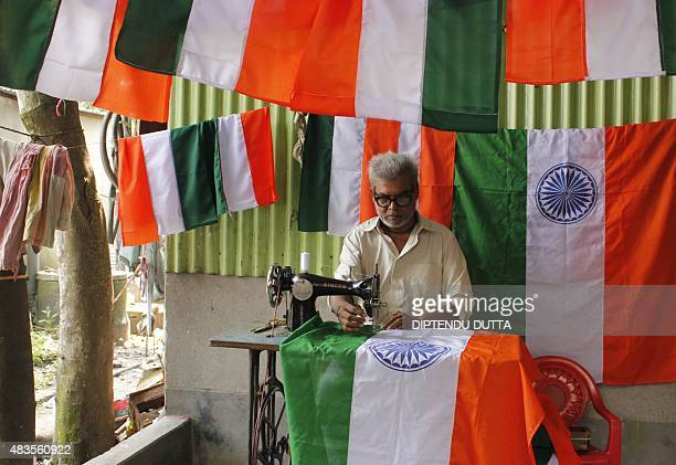 Indian tailor Satya Saha sews Indian national flags to be sold ahead of India's forthcoming Independence day celebrations in Siliguri on August 10...