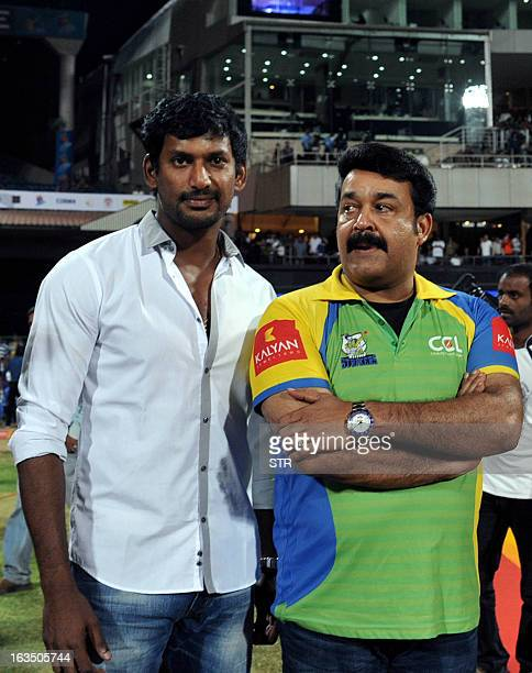 Indian Tamil film actor Vishal Krishna and Malayalam film actor Mohanlal Krishna attend the Celebrity Cricket League 2013 Finals between Karnataka...