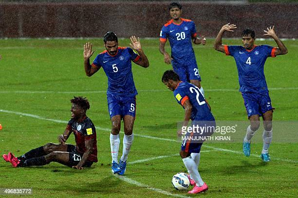 Indian team players raise their hands as Guam's forward Shane Andre Malcom cries foul during the the Asia Group D FIFA World Cup 2018 qualifying...
