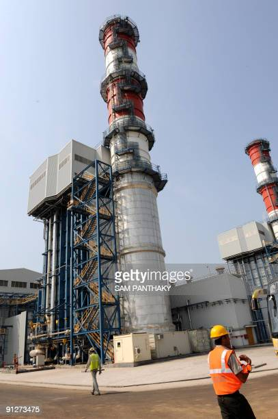 Indian technicians walk at The Sujen Mega Power Project at Kamrej on the outskirts of Surat some 275 kms from Ahmedabad on September 30 2009 This...