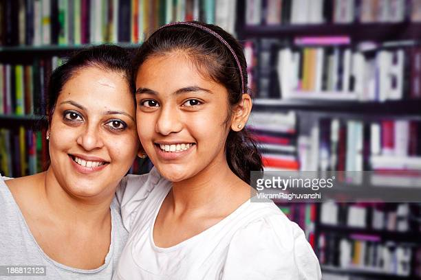 Indian Teenager Girl Daughter with her Mother in Library