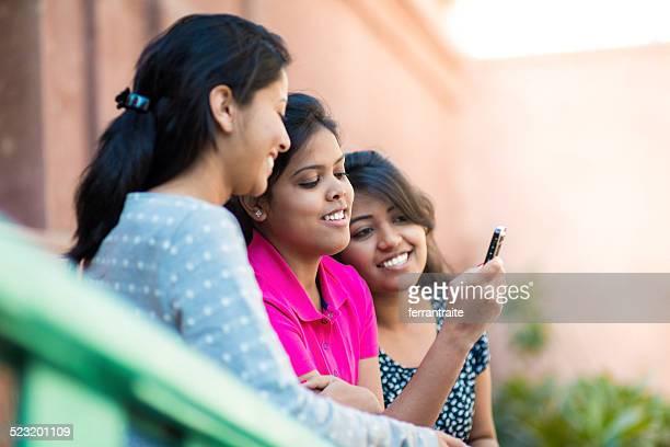 Indian teenager girls using smart phone
