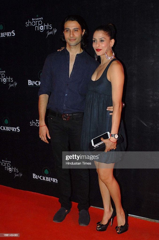 Indian Television actor Shilpa Saklani (R) along with her husband Apurva Agnihotri during the Blackberrys Sharp Night Fashion Show at Mehboob studio, Bandra on May 3, 2013 in Mumbai, India. The Blackberrys Sharp Night is a fashion show organised by Blackberrys to showcase their new Summer/Spring collection.
