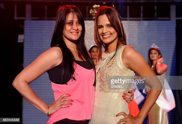 Indian television actress Jassi Kaur and Bollywood actress and model Nisha Harale pose for a photograph while attending the KamaSutra Miss Maxim 2014...