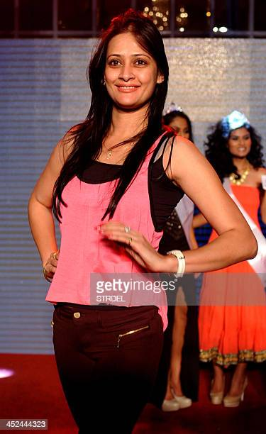 Indian television actress Jassi Kaur poses for a photograph while attending the KamaSutra Miss Maxim 2014 competition final in Mumbai on November 28...