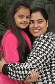 Indian television child actress Ruhanika Dhawan also known as Ruhi pose with her mother Dolly Dhawan in Amritsar on December 22 during promotional...
