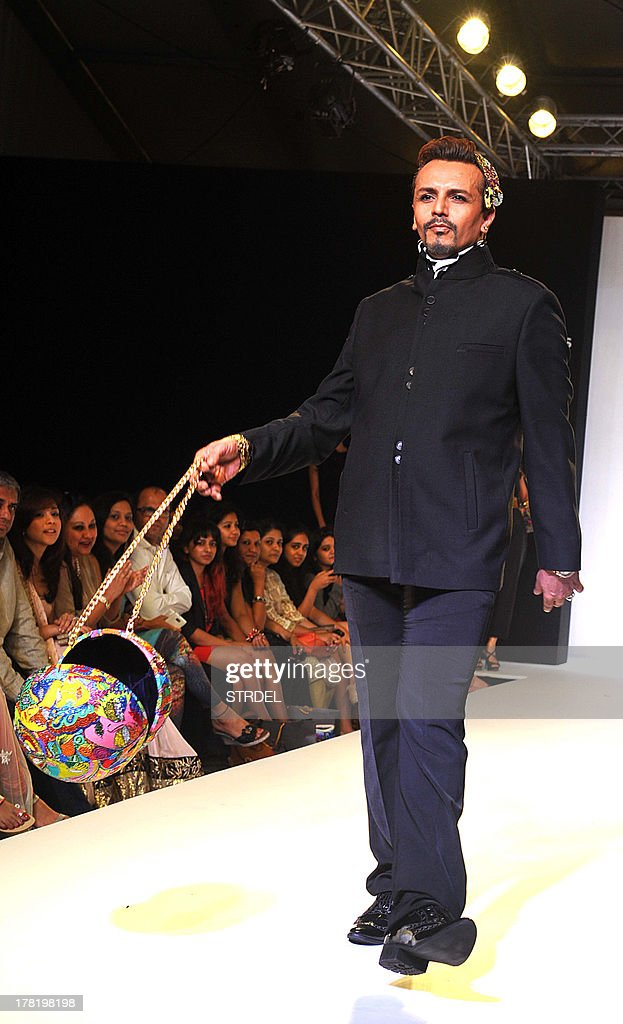 Indian television MTV anchor Imam Siddique showcases a creation by designers Tanvi & Pratiti, Ritika Mirchandani during the Lakme Fashion Week (LFW) Winter/Festival 2013 in Mumbai on August 27, 2013.