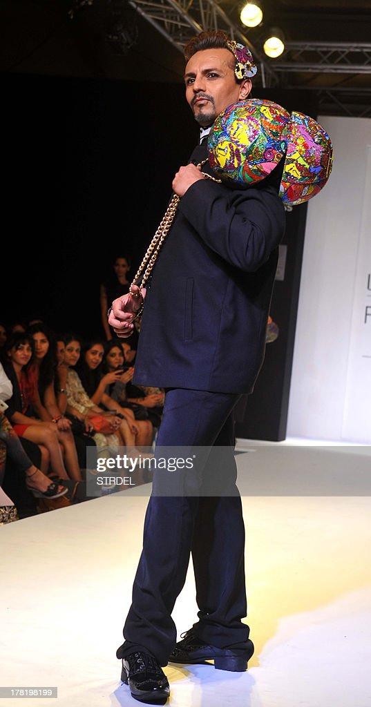 Indian television MTV anchor Imam Siddique showcases a creation by designers Tanvi & Pratiti, Ritika Mirchandani during the Lakme Fashion Week (LFW) Winter/Festival 2013 in Mumbai on August 27, 2013.