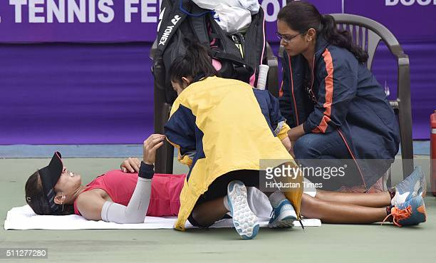 Indian Tennis player Ankita Raina gets a treatment during the Delhi Open 2016 at DLTA on February 19 2016 in New Delhi India