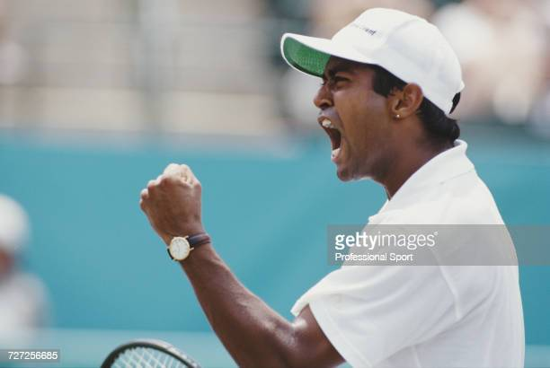 Indian tennis player Leander Paes competes for the India team to reach the finals and win the bronze medal in the Men's singles tennis event at Stone...