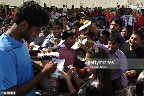 Indian tennis player Saketh Myneni signing autograph after winning the first reverse singles tie against Tsung Hua Yang of Chinese Taipei in the...