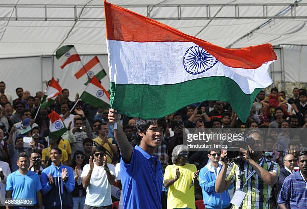Indian tennis player Somdev Devvarman thanks the crowd with tricolour Indian national flag after taming Ti Chen of Chinese Taipei in a grueling...
